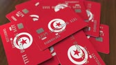tunisian flag : Pile of credit cards with flag of Tunisia. Tunisian banking system conceptual 3D animation Stock Footage