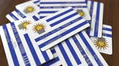 uruguay : Pile of credit cards with flag of Uruguay. Uruguayan banking system conceptual 3D animation Stock Footage