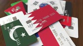 bahrein : Many credit cards with different flags, emphasized bank card with flag of Bahrain Vidéos Libres De Droits