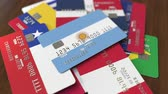 arjantin : Many credit cards with different flags, emphasized bank card with flag of Argentina Stok Video
