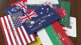 cardholder : Many credit cards with different flags, emphasized bank card with flag of Australia Stock Footage