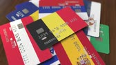 ベルギー : Many credit cards with different flags, emphasized bank card with flag of Belgium