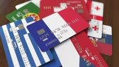 ローン : Many credit cards with different flags, emphasized bank card with flag of France
