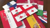 tarjeta de debito : Many credit cards with different flags, emphasized bank card with flag of Georgia