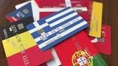 cardholder : Many credit cards with different flags, emphasized bank card with flag of Greece Stock Footage