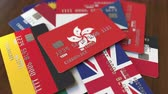 ローン : Many credit cards with different flags, emphasized bank card with flag of Hong Kong