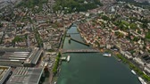 riverbank : Aerial hyperlapse of famous Kapellbrucke or Chapel Bridge within the cityscape of Lucerne, Switzerland