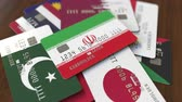 cardholder : Many credit cards with different flags, emphasized bank card with flag of Iran