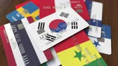 cardholder : Many credit cards with different flags, emphasized bank card with flag of South Korea