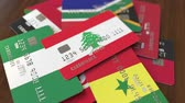 cardholder : Many credit cards with different flags, emphasized bank card with flag of Lebanon