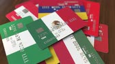mexicain : Many credit cards with different flags, emphasized bank card with flag of Mexico