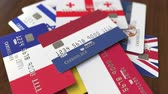 ローン : Many credit cards with different flags, emphasized bank card with flag of the Netherlands