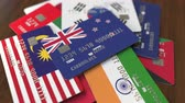 cardholder : Many credit cards with different flags, emphasized bank card with flag of New Zealand