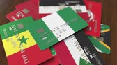 cardholder : Many credit cards with different flags, emphasized bank card with flag of Nigeria