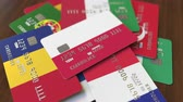 cardholder : Many credit cards with different flags, emphasized bank card with flag of Poland