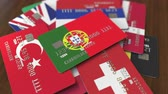 portugalia : Many credit cards with different flags, emphasized bank card with flag of Portugal
