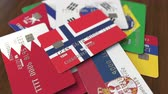 норвежский : Many credit cards with different flags, emphasized bank card with flag of Norway Стоковые видеозаписи