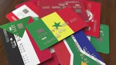 international economy : Many credit cards with different flags, emphasized bank card with flag of Senegal