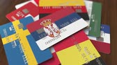 international economy : Many credit cards with different flags, emphasized bank card with flag of Serbia Stock Footage