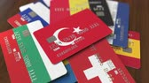 cardholder : Many credit cards with different flags, emphasized bank card with flag of Turkey