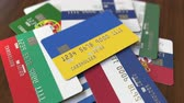cardholder : Many credit cards with different flags, emphasized bank card with flag of Ukraine Stock Footage