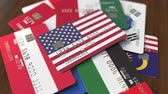 půjčka : Many credit cards with different flags, emphasized bank card with flag of the USA