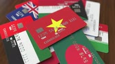 cardholder : Many credit cards with different flags, emphasized bank card with flag of Vietnam