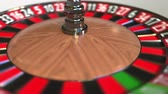 olasılık : Casino roulette wheel ball hits 9 nine red. 3D animation Stok Video