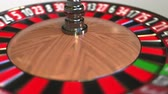 olasılık : Casino roulette wheel ball hits 14 fourteen red. 3D animation