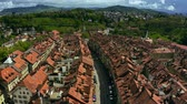 accogliente : Low altitude flight over the Old City tiled houses of Bern. Switzerland