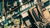 overview : Aerial top down view of rusty equipment of an obsolete industrial area Stock Footage