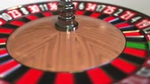 olasılık : Casino roulette wheel ball hits 1 one red. 3D animation