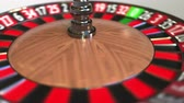 olasılık : Casino roulette wheel ball hits 8 eight black. 3D animation Stok Video