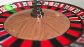 náhodný : Casino roulette wheel ball hits 2 two black. 3D animation
