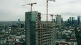 high rise buildings : FRANKFURT AM MAIN, GERMANY - APRIL 29, 2019. Aerial view of a modern building construction site Stock Footage