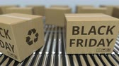 goede vrijdag : Carton boxes with BLACK FRIDAY text move on roller conveyor. Loopable 3D animation