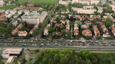 moving down : Aerial time lapse of a traffic jam in residential area of a European city