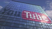 yansıtıcı : Logo of YOUTUBE on a media facade with reflecting cloudy sky, editorial animation Stok Video