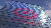 obiettivo : TARGET logo against modern building reflecting sky and clouds, editorial animation