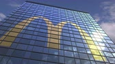 mcdonalds : Logo of MCDONALDS on a media facade with reflecting cloudy sky, editorial animation
