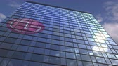 средства массовой информации : Logo of LG on a media facade with reflecting cloudy sky, editorial animation Стоковые видеозаписи