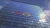 reklama : Logo of GOOGLE on a media facade with reflecting cloudy sky, editorial animation
