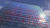 arranha céus : Logo of GENERALI on a media facade with reflecting cloudy sky, editorial animation