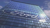 gázló : FORD logo on modern building reflecting sky and clouds, editorial animation