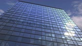 yansıtıcı : CREDIT SUISSE logo against modern building reflecting sky and clouds, editorial animation Stok Video