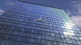yansıtıcı : MERCEDES-BENZ logo against modern building reflecting sky and clouds, editorial animation