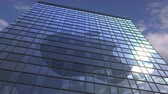 reclame : Logo of APPLE INC on a media facade with reflecting cloudy sky, editorial animation