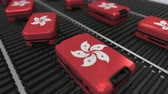 roller conveyor : Many travel suitcases featuring flag of Hong Kong. Tourism conceptual animation
