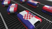 croata : Many travel suitcases featuring flag of Croatia. Croatian tourism conceptual animation