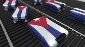 cubano : Many travel suitcases featuring flag of Cuba. Cuban tourism conceptual animation
